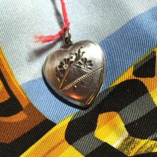 solid white gold heart locket @selectioncoste.com